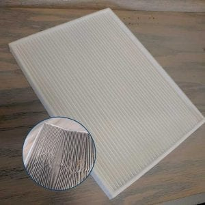 Show a damaged cabin air filter