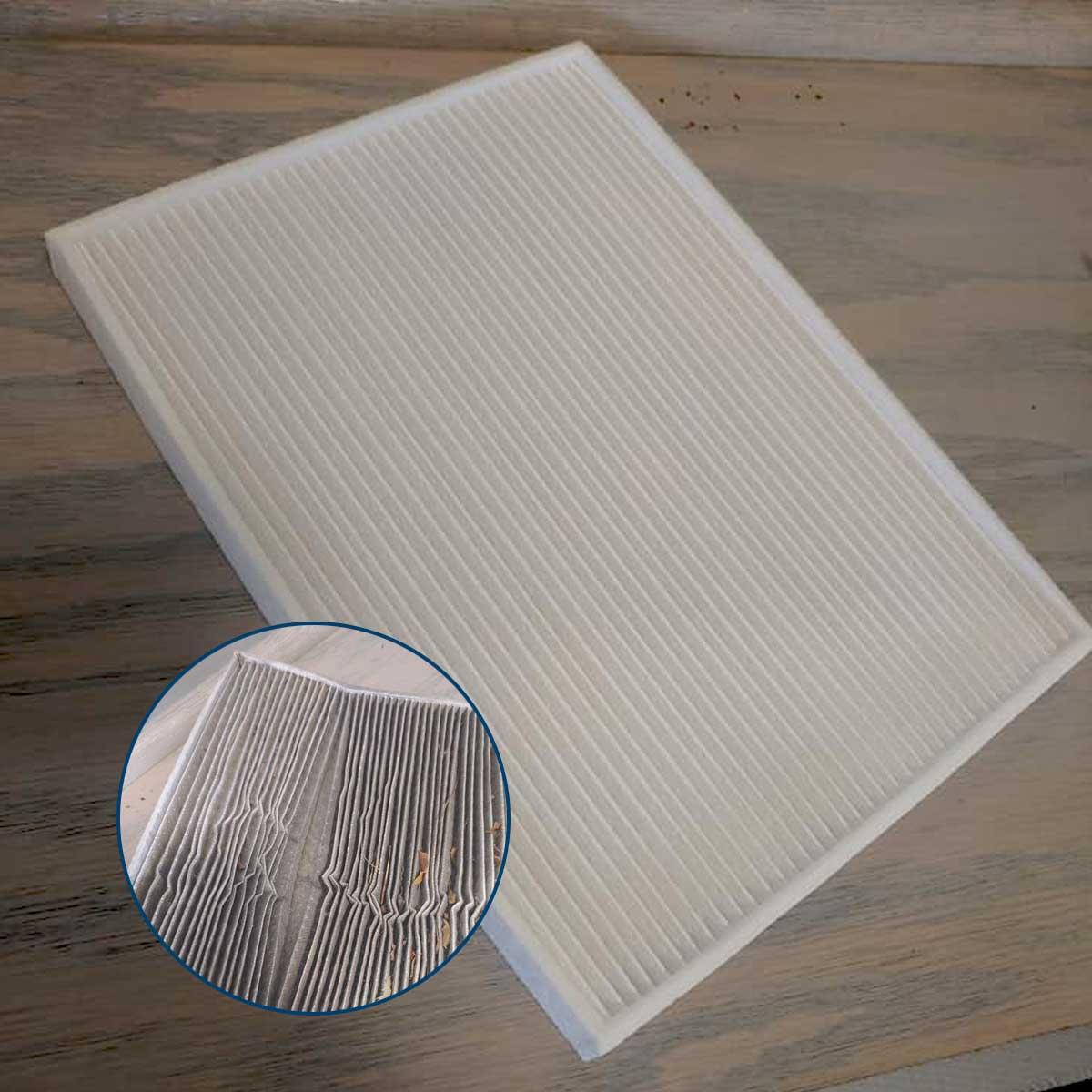 Show a damaged cabin air filter